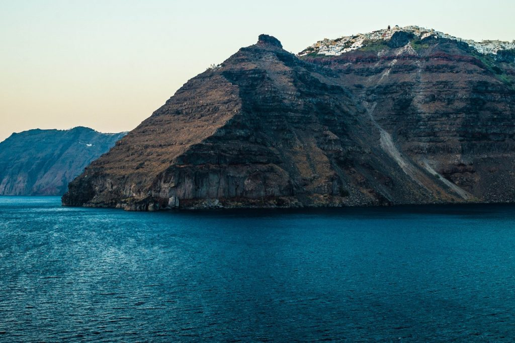 Cliff Diving In Santorini On A Mediterranean Adventure Holiday